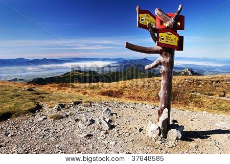 autumnal view from rohace mountains with guidepost - west high tatra mountains- Slovakia
