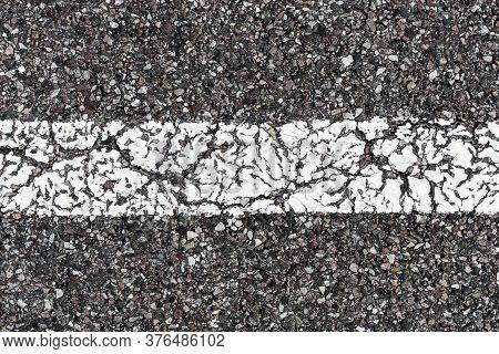 White Paint Line. Grunge Asphalt Structure Texture. Closeup Granular Noise Background. Street Grain