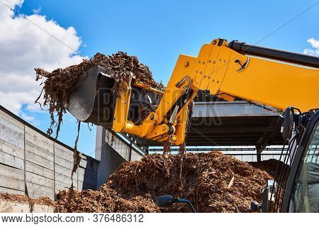 Bucket Loader Moving Wood Bark In A Woodworking Industry