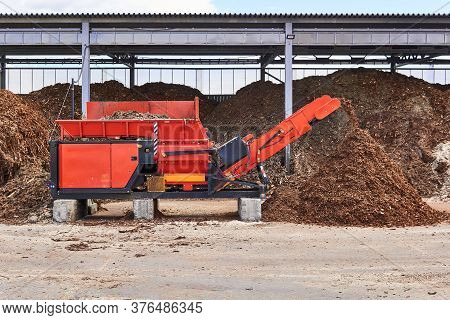 Industrial Wood Shredder Producing Wood Chips From Bark