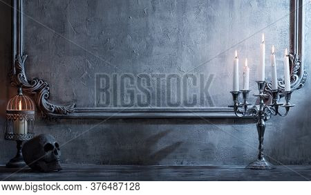 Mystical Halloween Still-life Background. Skull, Candlestick With Candles, Old Fireplace. Horror And