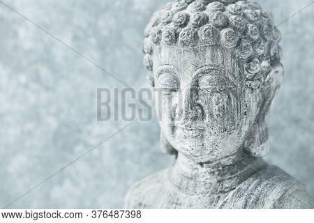 Meditating Buddha Statue On Bright Background. Copy Space.