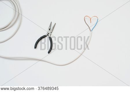 The White Wire In The Form Of Heart