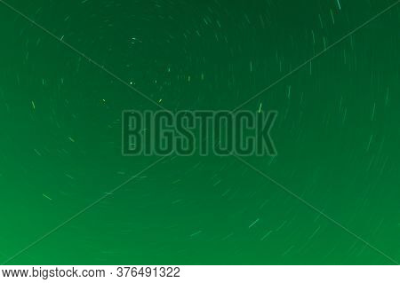 Background Of Round Or Circular Star Track Or Trajectory On The Green Clear Night Sky. Symbol Of Spa