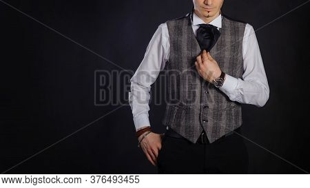 The Handsome Caucasian Young Man In A White Shirt And Suit Stand