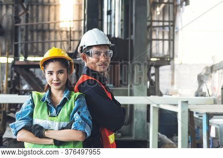 Portrait Images Of Engineers Asian Man And Woman Are Standing In Workplace Which Is And Industrial F