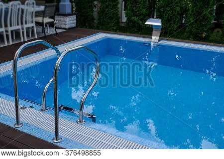 View Of A Empty Swimming Pool With Blue Wa