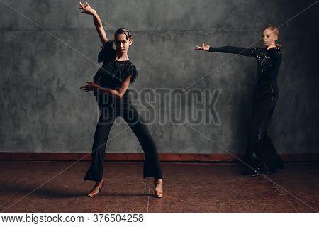 Young Couple Dancing In Ballroom Dance Cha-cha-cha.