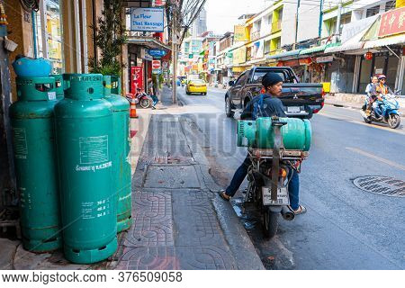 A Man Carries A Gas Cylinder On A Motobike. Delivery Of Gas Cylinders In Thailand. Bangkok / Tailand