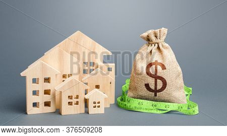 Residential Houses And A Dollar Money Bag. Property Real Estate Valuation. Buying And Selling, Fair