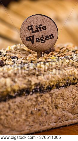 Detail Of Rolled Oat Bread With Wooden Plate Written In English: Vegan Life. Vegan Lifestyle, Health