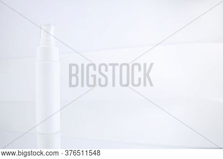 White Unbranded Flacon On Light Mockup. Facial, Body Care Cosmetics Bottle With Dispenser. Blank Pac