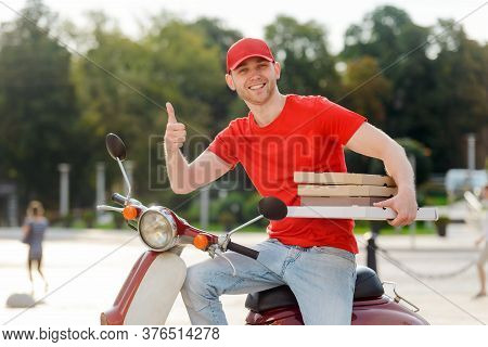 Handsome Deliverer Is Showing Thumb Up To Ensure The Service Is Good