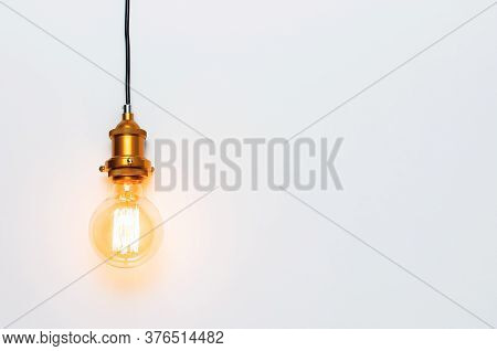 Creative Idea Concept, Designer Lamp, Modern Interior Item. Vintage Fashionable Edison Lamp On Light