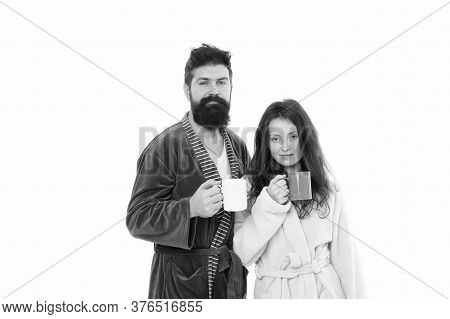 Family Couple Drink Tea In Bathrobe. Couple In Love. Good Morning Coffee. Man And Woman Drinking Mil