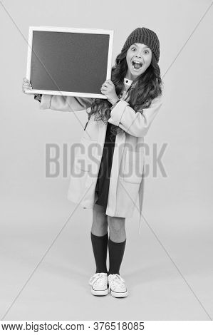 Retro And Modern School. Small Girl Enjoy Autumn. Stylish Schoolgirl Blackboard. Copy Space For Ad.