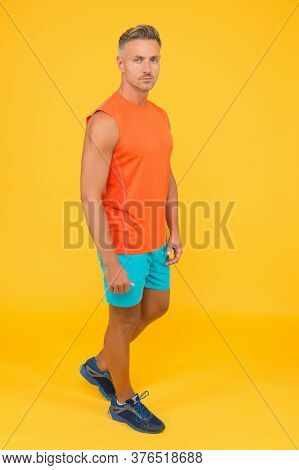 Muscular Body. Good Shape. Strong Sportsman In Gym Clothes. Sportsman Physically Fit. Active Sportsm