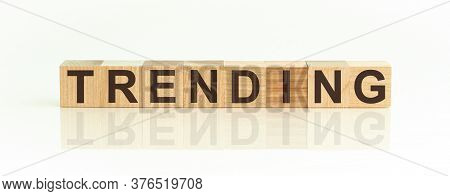 Text Of Trends On Wooden Cubes On Beige Background
