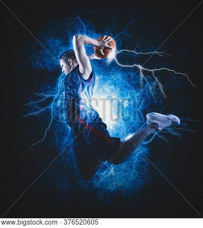 Basketball player players in action. Basketball concept on lightning background