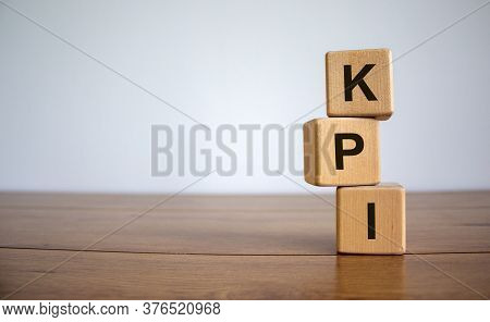 Concept Word 'kpi' On Cubes On A Beautiful Wooden Table. White Background. Business Concept. Copy Sp