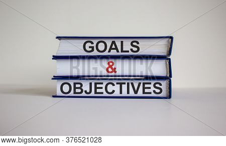 Books With Text 'goals And Objectives' On Beautiful White Background. Business Concept. Copy Space.