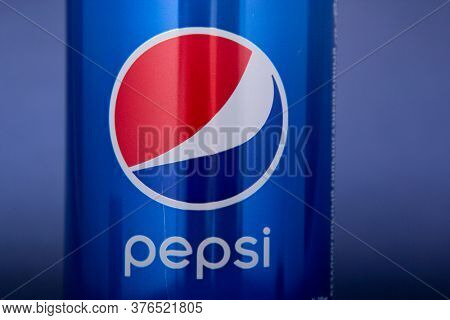Belgorod , Russia - MAY, 17, 2020: Pepsi drink in a can on ice isolated on blue background. Carbonated soft drink produced by PepsiCo.