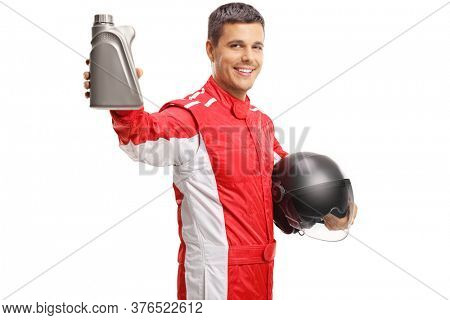 Car racer holding a helmet and a bottle of motor oil isolated on white background