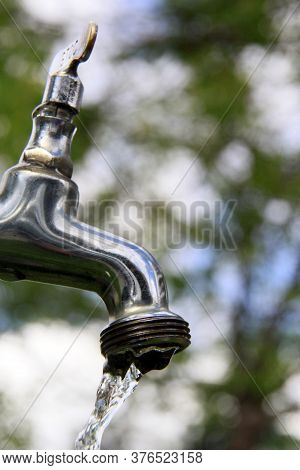 Salvador, Bahia / Brazil - November 9, 2013: Faucet Is Seen Spouting Water In A Residence In The Cit