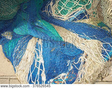 Fishing Gear And Equipment In The Port. Lay Out Various Fishing Nets, Bobbers, Mooring Line, Floats.