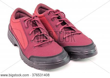 A Pair Of Simple Cheap Red Hiking Shoes Isolated On White Background - Perspective Close-up View