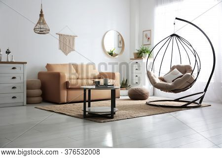 Stylish Leather Sofa And Swing Chair In Modern Living Room Interior