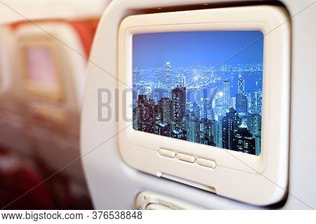 Aircraft Monitor In Front Of Passenger Seat Showing Panorama Vire Hongkong Cityscape At Night , Hong