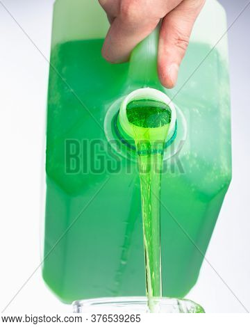 liquid soap in plastic bottle, pouring by hand