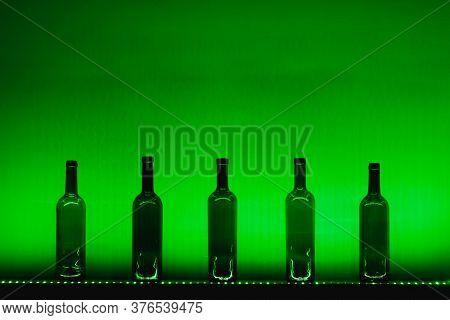 abstract empty wine bottles with green led illumination
