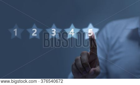 Five Stars (5) Rating With A Businessman Touching Screen, Concept About Positive Customer Feedback A