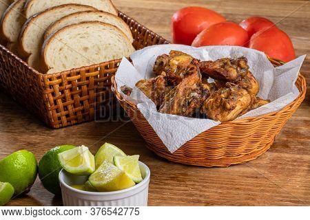 Brazilian Style Deep Fried Chicken And Sliced White Bread. Called Frango A Passarinho