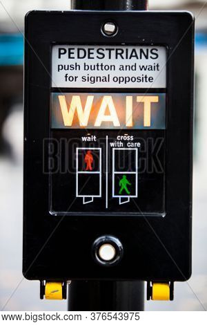 Close up of crosswalk pushbutton