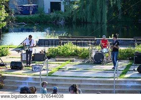 Anoka, Mn/usa - July 15, 2020. A Band Performs At A Free Community Concert Along The Rum River.