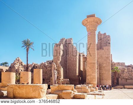 Luxor, Egypt - February 2020: Columns And Ruins Of Karnak Temple, Long View. A Lot Of Tourists Seein