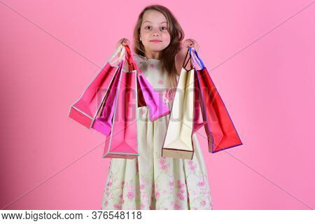 Schoolgirl With Red, Pink And Yellow Packets Does Shopping