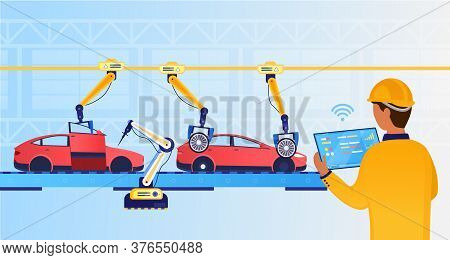 An Engineer At A Futuristic Factory Sets Up An Assembly Line Using A Tablet. Automotive Line. Indust