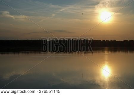 Dramatic And Colorful Sunset Over A Forest Lake Reflected In The Water. Blakheide, Beerse, Belgium.