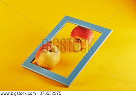 Ugly Fruit Or Vegetable. A Very Ugly Peach Mutant And A Blue Frame On An Orange Background. Ugly Fru
