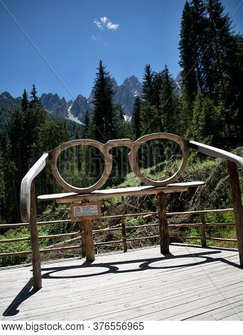 Wooden Glasses In The Park At The Foot Of The Italian Dolomites Trees, Blue Sky, Cloud