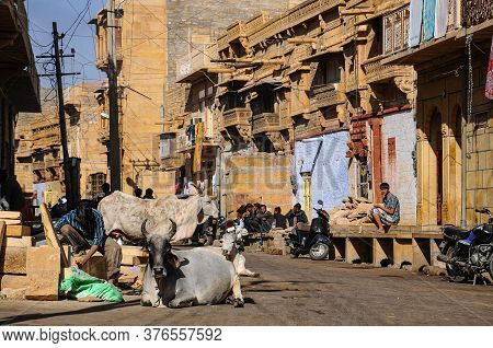 Jaisalmer, India - Dec 29, 2019: Indian Rajasthani People In National Clothes In The Streets Of Jais