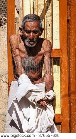 Jaisalmer, India - Dec 31, 2019: Indian Rajasthani Old Man In National Clothes In The Streets Of Jai