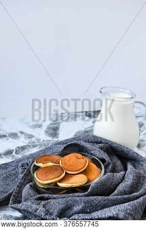 Pancake Porridge, Mini Pancakes In A Bowl With Maple Syrup. Milk On Background. Dutch Mini Pancakes