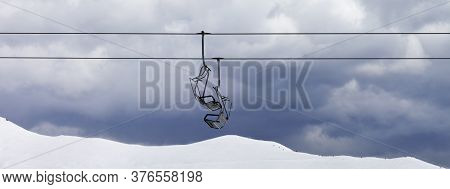 Chair Lifts And Snowy Off-piste Slope At Gray Day. Caucasus Mountains, Georgia, Region Gudauri At Wi