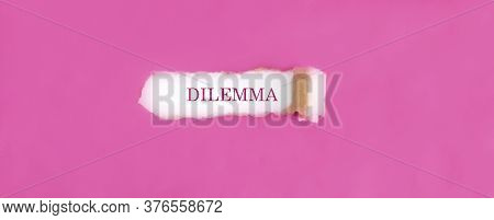 The Text Dilemma Appearing Behind Torn Pink Paper.