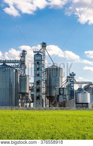 Silver Silos On Agro-processing And Manufacturing Plant For Processing Drying Cleaning And Storage O